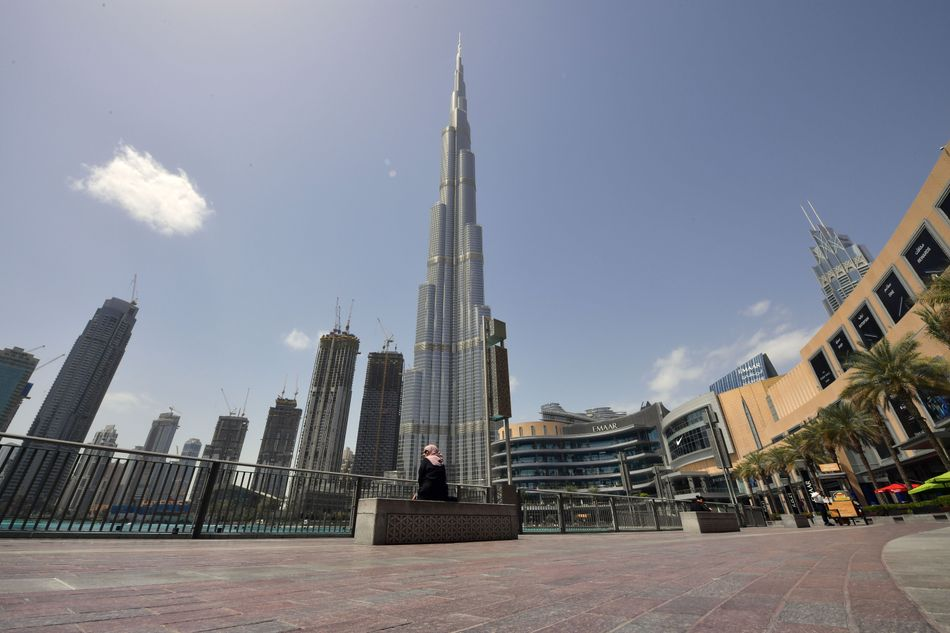 Burj Khalif, the tallest building in the world, towers above the Dubai Mall's closed compound during the coronavirus pandemic on March 23, 2020.